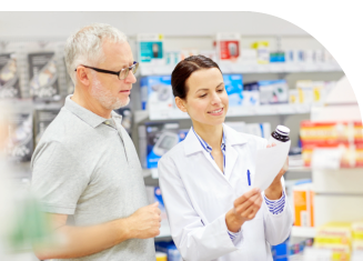 female pharmacist and senior man looking at the prescription