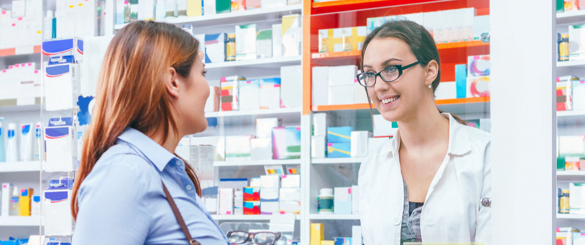 female pharmacist and female customer looking at each other