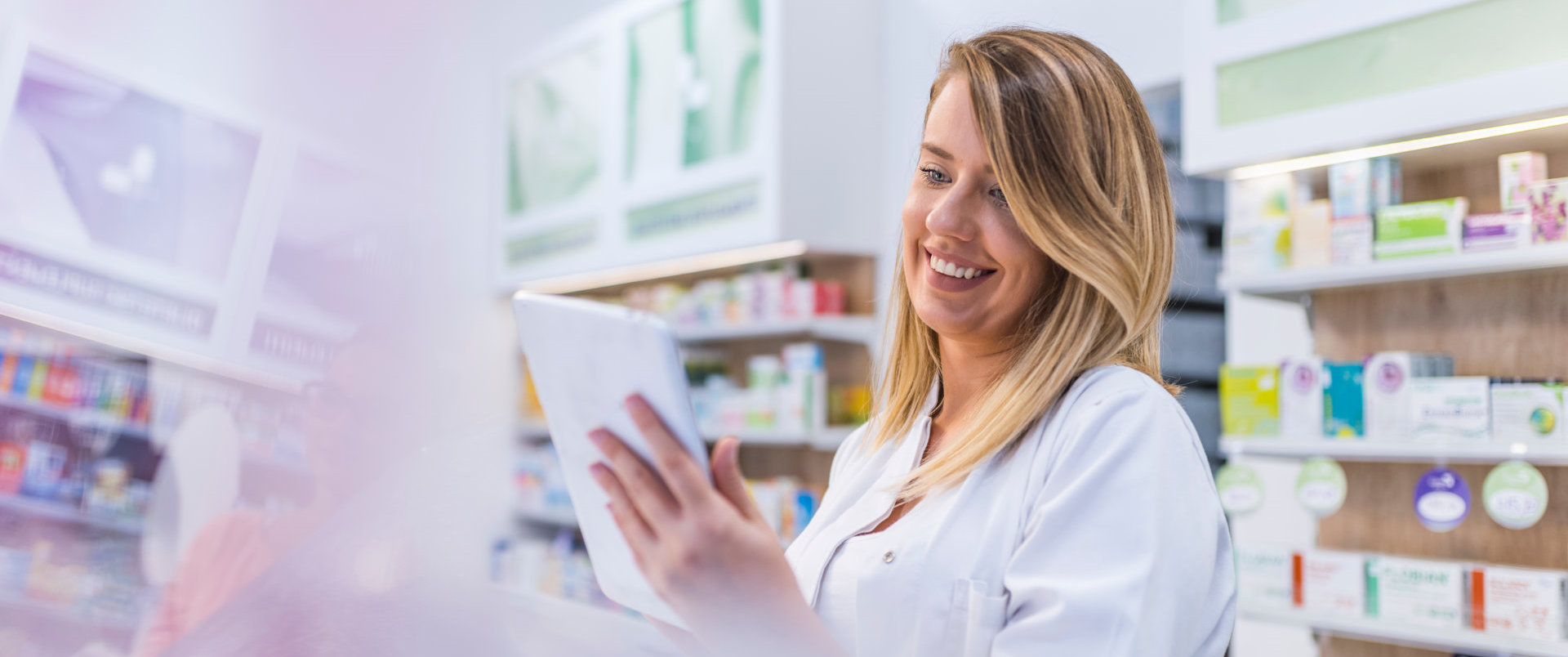 female pharmacist looking at the tablet