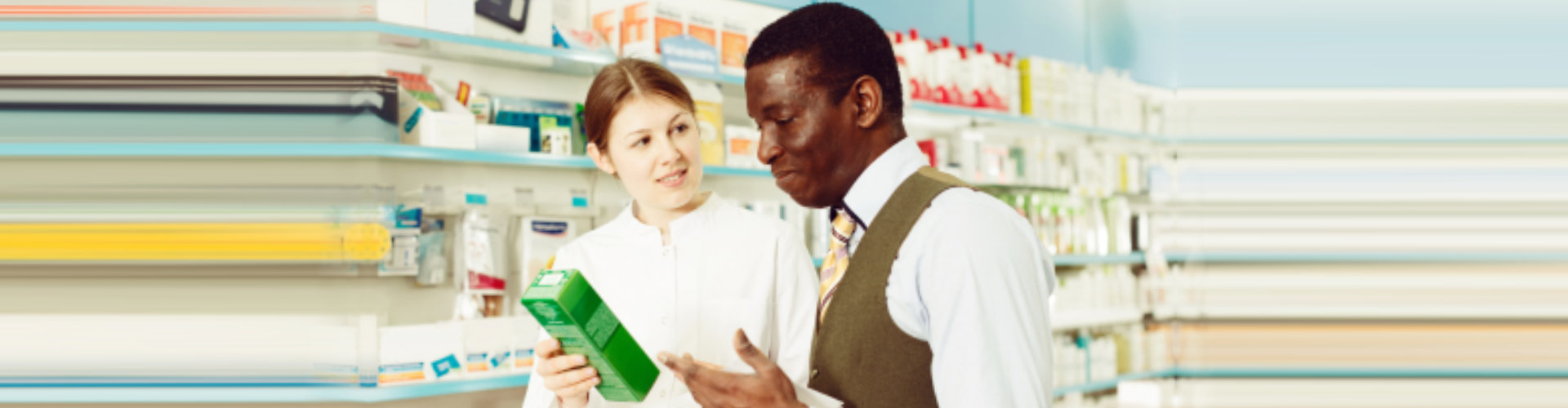 female pharmacist and male customer looking at the box