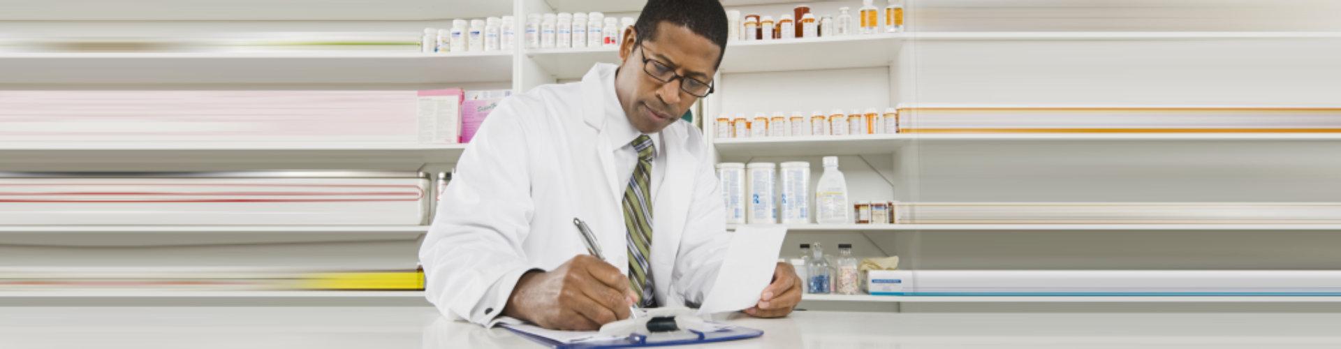 male pharmacist smiling